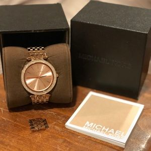 Used Rose Gold-tone stainless steal wrist watch.